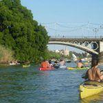 friends kayaking seville